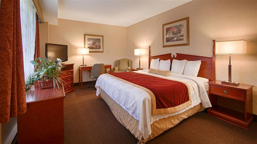 Best Western Halton Hills - For the ultimate in comfort, king apartment suite room with full kitchen and living area perfect for small meetings.