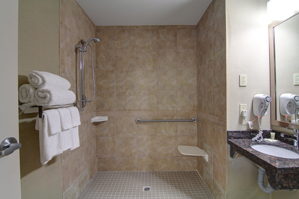 Best Western Plus Bowmanville - Mobility Accessible Bathroom with Roll-In Shower. We designed our mobility accessible rooms for easy wheelchair access.
