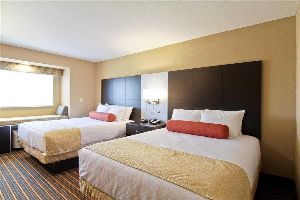 Best Western Plus Woodstock Inn & Suites - Deluxe room with two triple-sheeted Simmons® Beautyrest® queen beds.