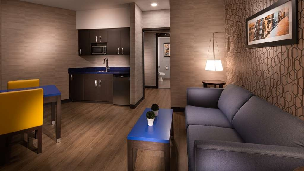 GLo Best Western Kanata Ottawa West - This king suite offers plenty of space to sleep, work and dine.