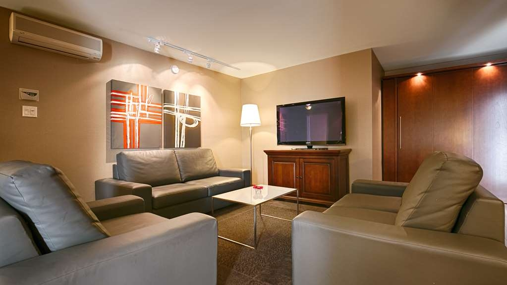 "Best Western Premier Hotel Aristocrate - Enjoy the ""suite"" experience with a cozy living room."