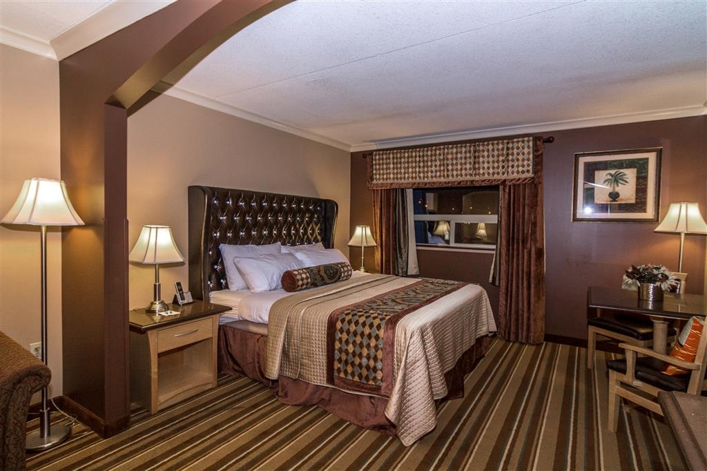 Best Western Marquis Inn & Suites - Stay comfortable for 2 in our suite king bedroom.