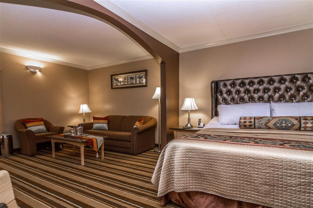 Best Western Marquis Inn & Suites - After a long day of working relax the day way in this king suite featuring a massage bed.