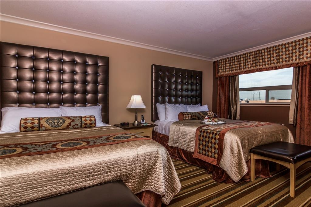 Best Western Marquis Inn & Suites - This family suite features two beds, free high-speed internet and a flat screen TV.