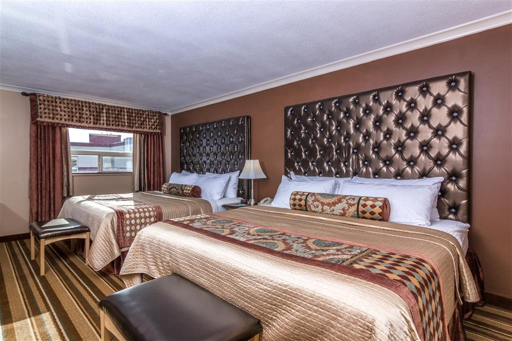 Best Western Marquis Inn & Suites - Sink into our two king comfortable beds each night and wake up feeling completely refreshed.