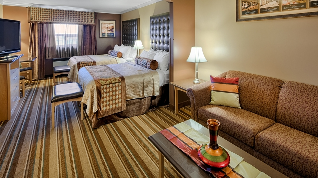 Best Western Marquis Inn & Suites - At the end of a long day, relax in our clean, fresh guest rooms.