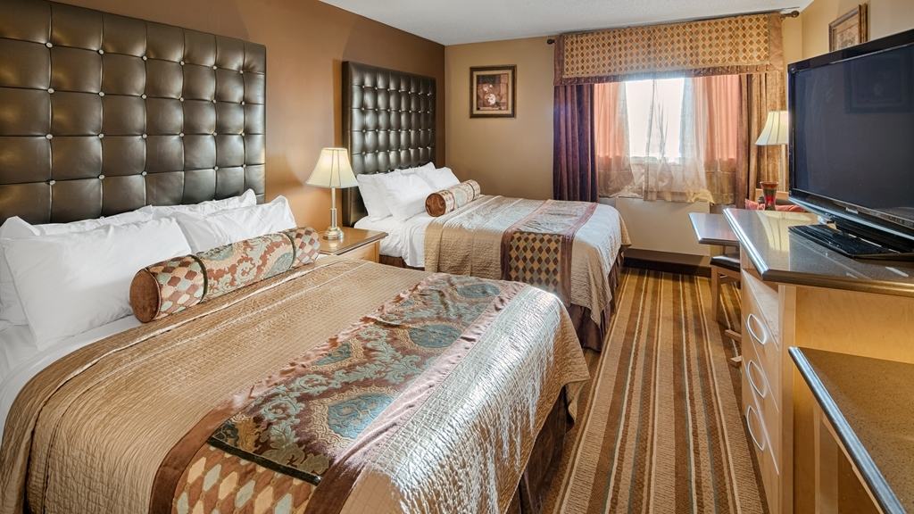 Best Western Marquis Inn & Suites - Sink into our comfortable beds each night and wake up feeling completely refreshed.