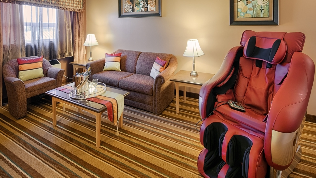 Best Western Marquis Inn & Suites - Spend some time after a hectic day in the living room featured in our king suite.