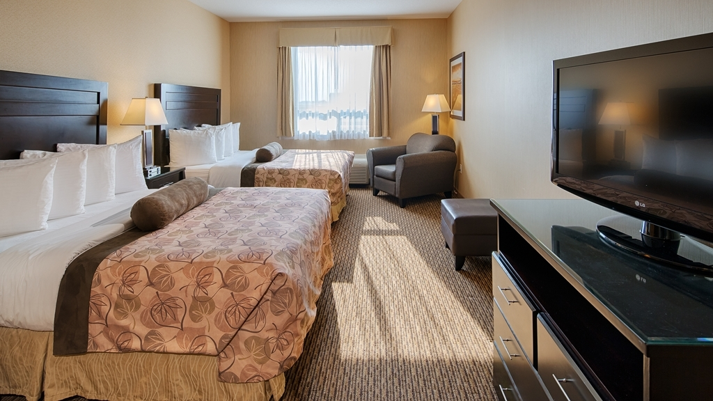 "Best Western Plus Estevan Inn & Suites - Your comfort is our first priority. Rejuvenate, refresh and restore your energy in one of our 95 eco friendly rooms. Each of our rooms are equipped with a heating/cooling system, which will be comfortably set for your arrival. While making your stay with us as your ""home away from home"" each room features a LCD television, refrigerator,and microwave. Keep in touch with the big world out there with your in room wifi connection. Stay in for the night and enjoy your favorite TV show on one of the 60 cable channels available, or if it's a work night pull yourself up to our large desks with ergonomic chairs, be productive and work the night away. Bathrooms are equipped with standard tub/shower units. Complimentary toiletries are provided and restocked daily when our friendly housekeepers tend your room. We also have rooms which feature shower only bathrooms available."