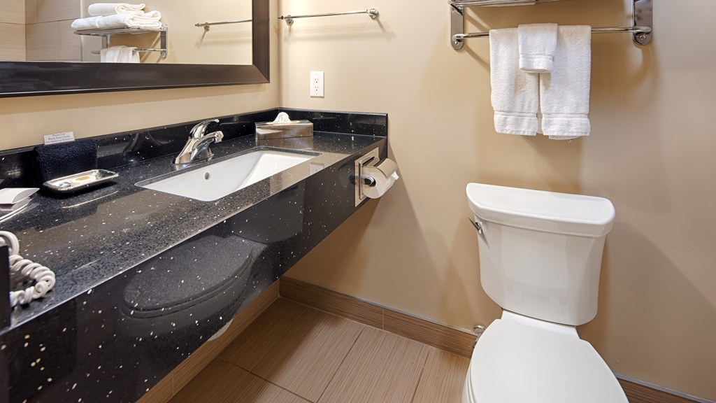 Best Western Plus Moose Jaw - All guest bathrooms have a large vanity with plenty of room to unpack the necessities.