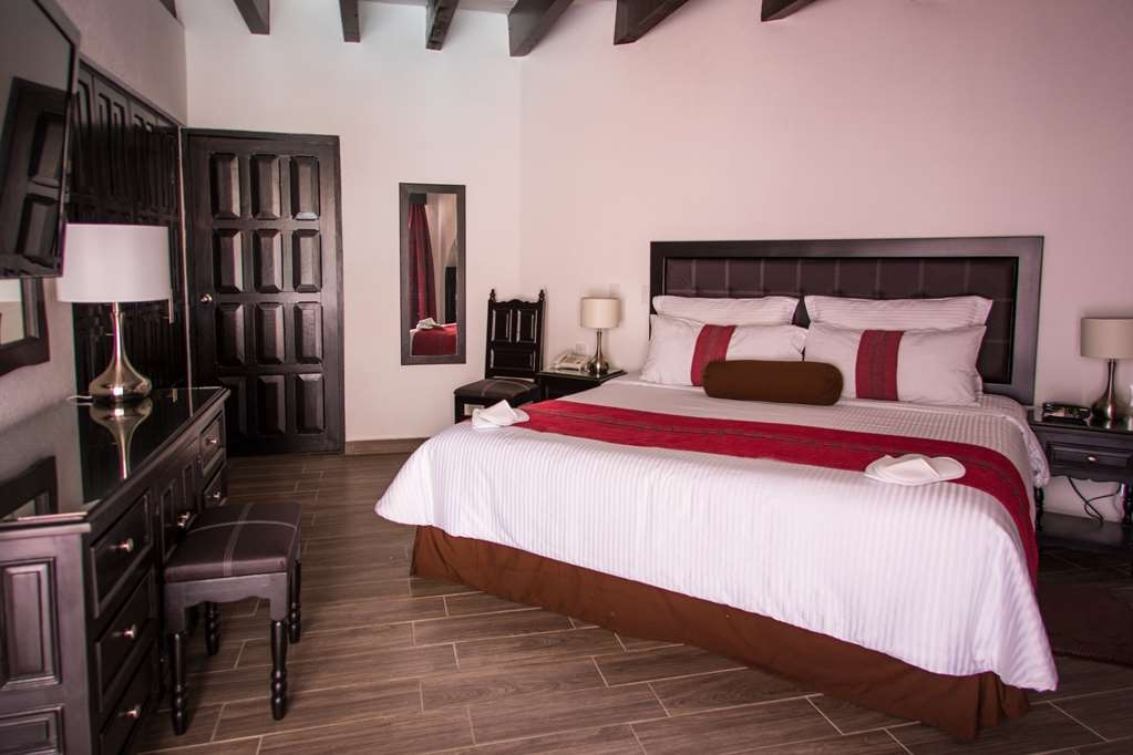 Best Western Plus Posada de Don Vasco - Chambres / Logements