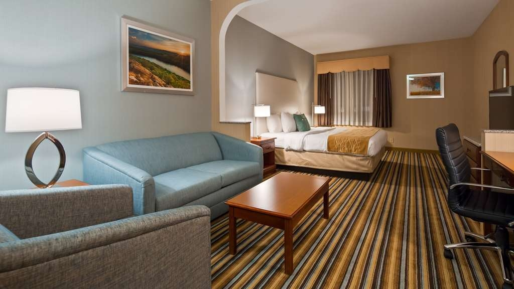 Best Western Plus New England Inn & Suites - Our king suites are 33% larger than standard guest rooms and feature a twin pull out couch. Extra space to relax or work.