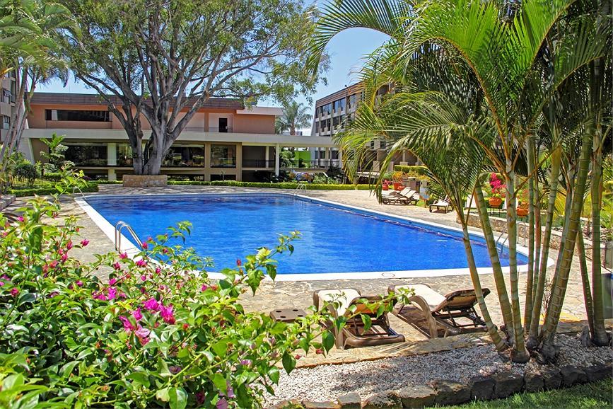 Best Western Irazu Hotel & Studios - Piscina Jardines at the Best Western Irazu Hotel & Studios in San Jose, Costa Rica