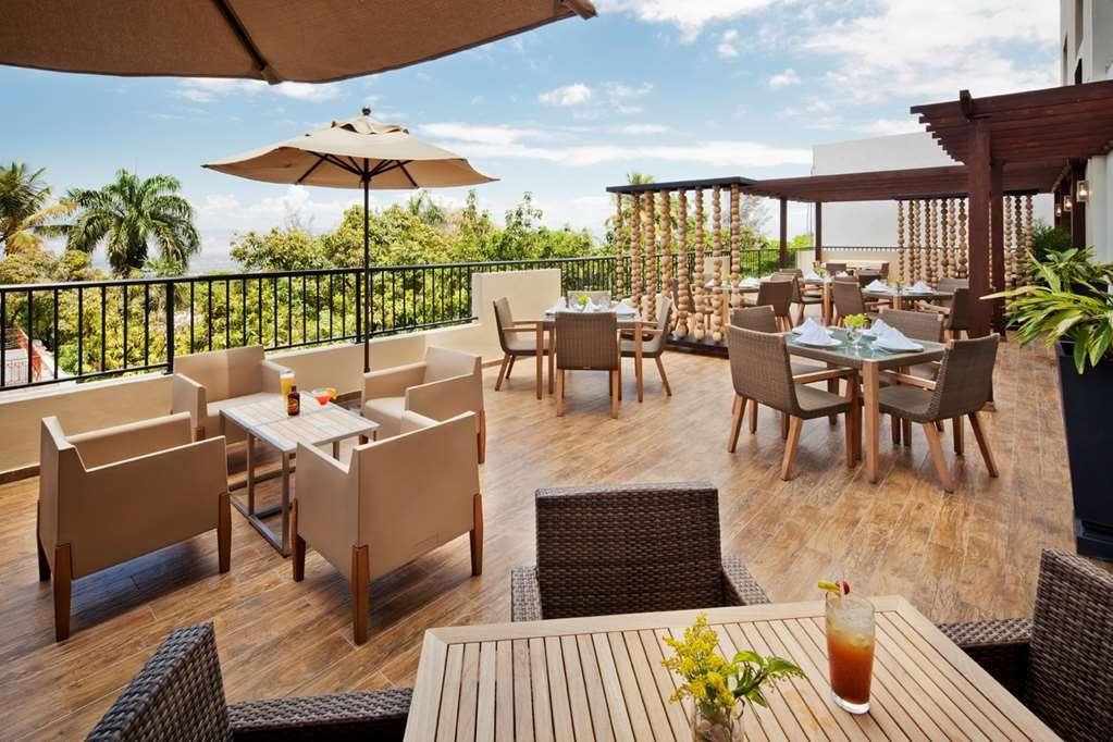 Best Western Premier Petion-Ville - Enjoy breathtaking views from the breezy Whisky Bar & Terrace with table or lounge seating and retractable roof Rain or Shine it's always a good time!