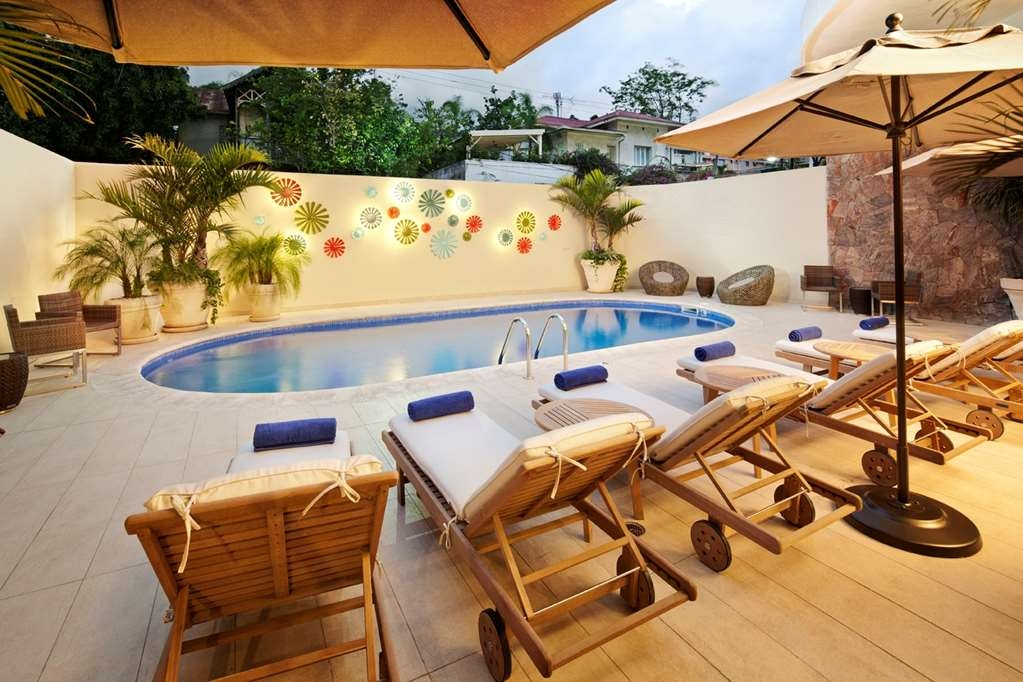 Best Western Premier Petion-Ville - The Oxygene Spa & Wellness outdoor pool area offers lounge chairs in addition to poolside service.