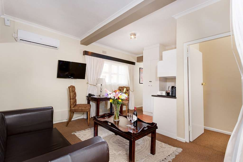 Best Western Cape Suites Hotel - 1 bathroom with bath and shower, kitchenette, balcony (selected rooms only), tea/coffee supplies, flat panel satellite television (DSTV), air-conditioning, telephone, room-safe and hair dryers.