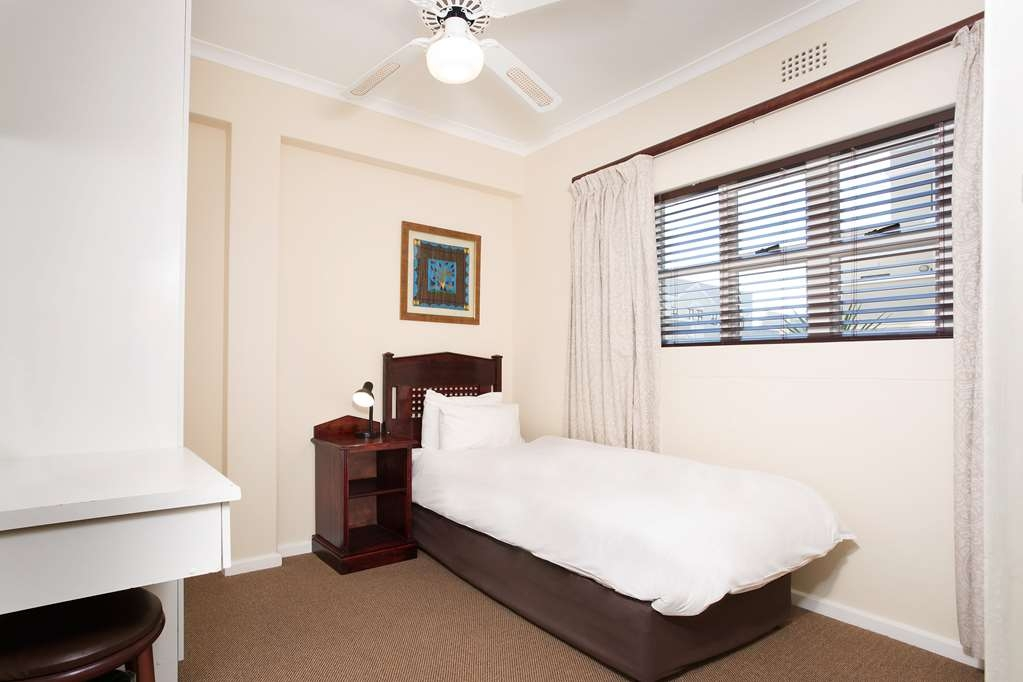 Best Western Cape Suites Hotel - Two bathrooms, kitchenette, separate lounge, tea/coffee supplies, flat panel satellite television (DSTV), air-conditioning, telephone, room-safe and hair dryers.