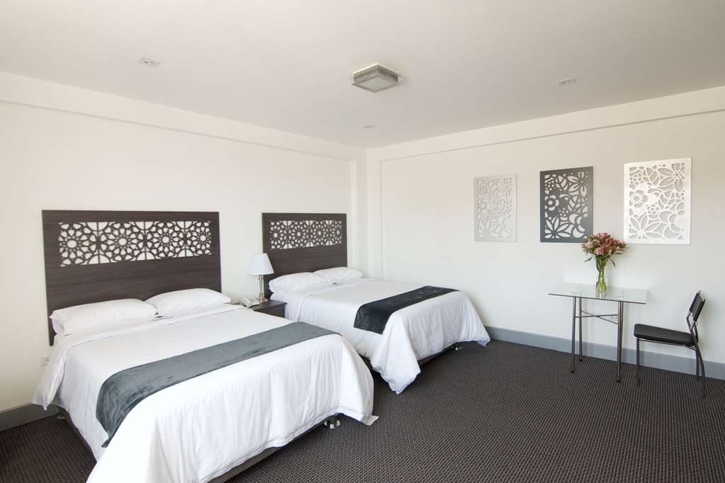 SureStay Plus Hotel by Best Western Tierrasur Colonial - Chambres / Logements