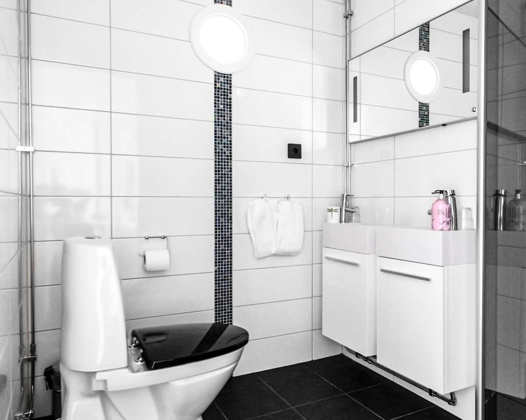 Best Western Hotell Karlshamn - Suite bathroom with his and her sink.