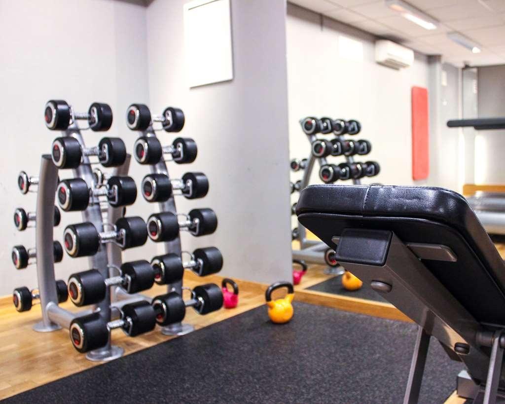 Best Western Hotell Karlshamn - Bench, mirror, and free weights in gym.