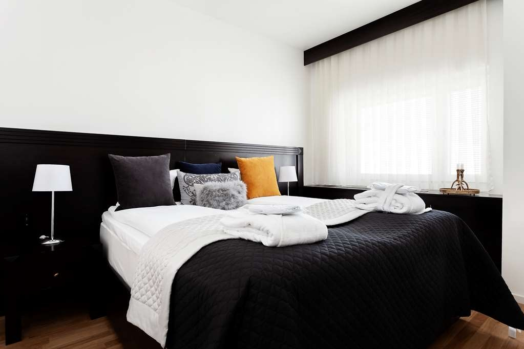 Best Western Stockholm Jarva - Bedroom in the Suite with One Queen Size Bed and Separate Living Area