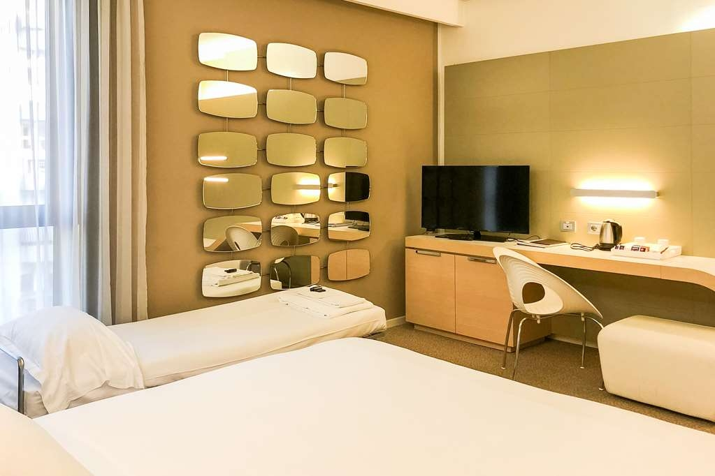 Best Western Plus Tower Hotel Bologna - Standard Triple Room - 1 king bed with extra bed (190cmx85cm or 195cmx75cm)